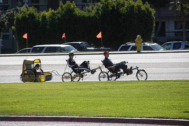 Mission Bay Bike Path Tandem trike rig on trail. Two Penninger recumbent trikes with a special needs trailer on approach to bridge on West Mission Bay Drive.