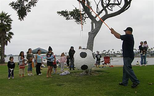Mission Bay Bike Path   Birthday party with pinata next to trail