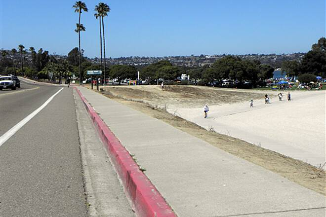 Mission Bay Bike Path   Bike lane on Crown Pt. Blvd. can be used to transition between the Ingraham St. bridge and the Bay Walk trail (seen at right) by going thru the Crown Pt. Park parking lot.