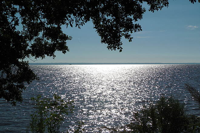 Mobile Airport Perimeter Trail Sunlight on Mobile Bay The view that greets you at the south end of the trail where it meets Bayfront Rd.