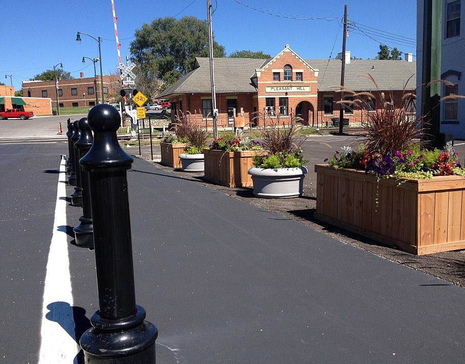 MoPac Trail (Pleasant Hill) Pleasant Hill cycle track A cycle track winds through the city's Historic Downtown District. In the background, you can see the town's MoPac depot, dating back to 1903. Photo courtesy City of Pleasant Hill.