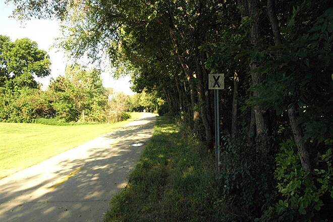 MoPac Trail West MOPAC Trail A shot of the trail wit one of the original railroad signs visible on the right.