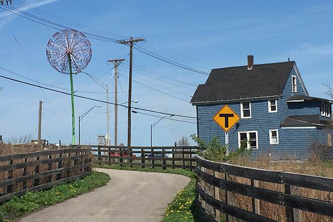Morgana Run Trail Sculpture Marks the Western End of the Trail The western end of the Morgana Run Trail at E. 49th Street is marked by a large dandelion sculpture entitled 'Rotoflora.'  On the other side of E. 49th Interstate 77, heads toward downtown Cleveland.  April 18, 2017.