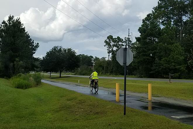 Moultrie Trail Trails are transportation This trail leads from town out to the municipal airport and passes by the country club golf course along the way. This guy was riding home from work at 5pm. Said hello and warned me that rain was coming. He's a regular commuter on the trail.