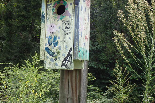 Muddy Creek Greenway Bird house along trail This is one of many highly decorated birdhouses along the trail.