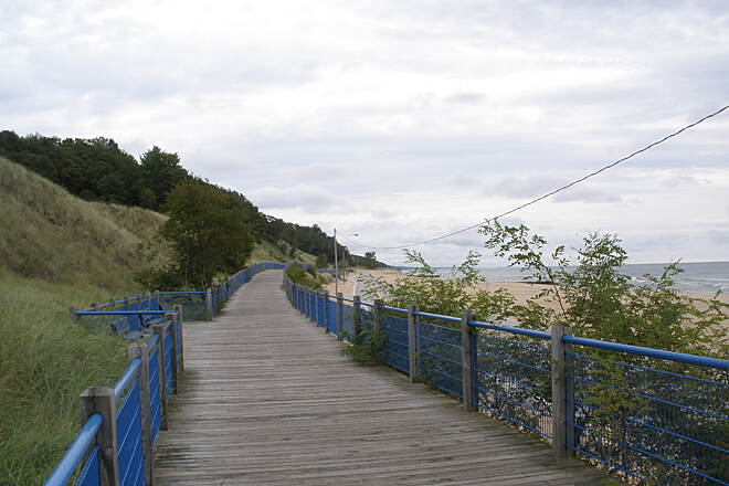 Muskegon Lakeshore Trail Boardwalk along Lake Michigan. Sand dunes on one side, beach on the other side.
