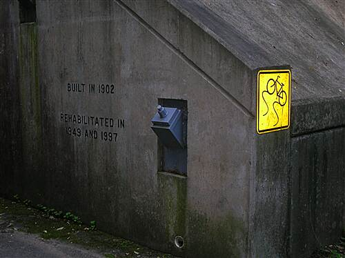 National Road Bikeway  Close up of tunnel's retaining rod and signs at northern portal