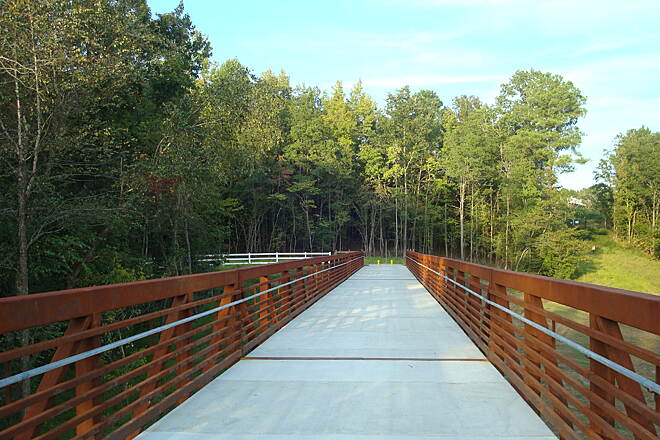 Neuse River Trail Smith Creek Greenway Bridge The bridge connects Wake Forest to the Neuse River Trail. The trailhead can be accessed from Burlington Mills Rd. This view is looking east toward the Wake Forest end of the bridge.