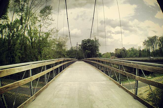 Neuse River Trail Bridge and Storm Clouds I went biking on an overcast afternoon and I took this picture of the bridge leading to Horseshoe Farm Park with a wide angle lens.