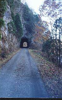 New River Trail State Park First tunnel There are two tunnels along the trail.  This is the first at mile 28.  Its length is 193 feet.  The sheer cliffs added diverse scenery.