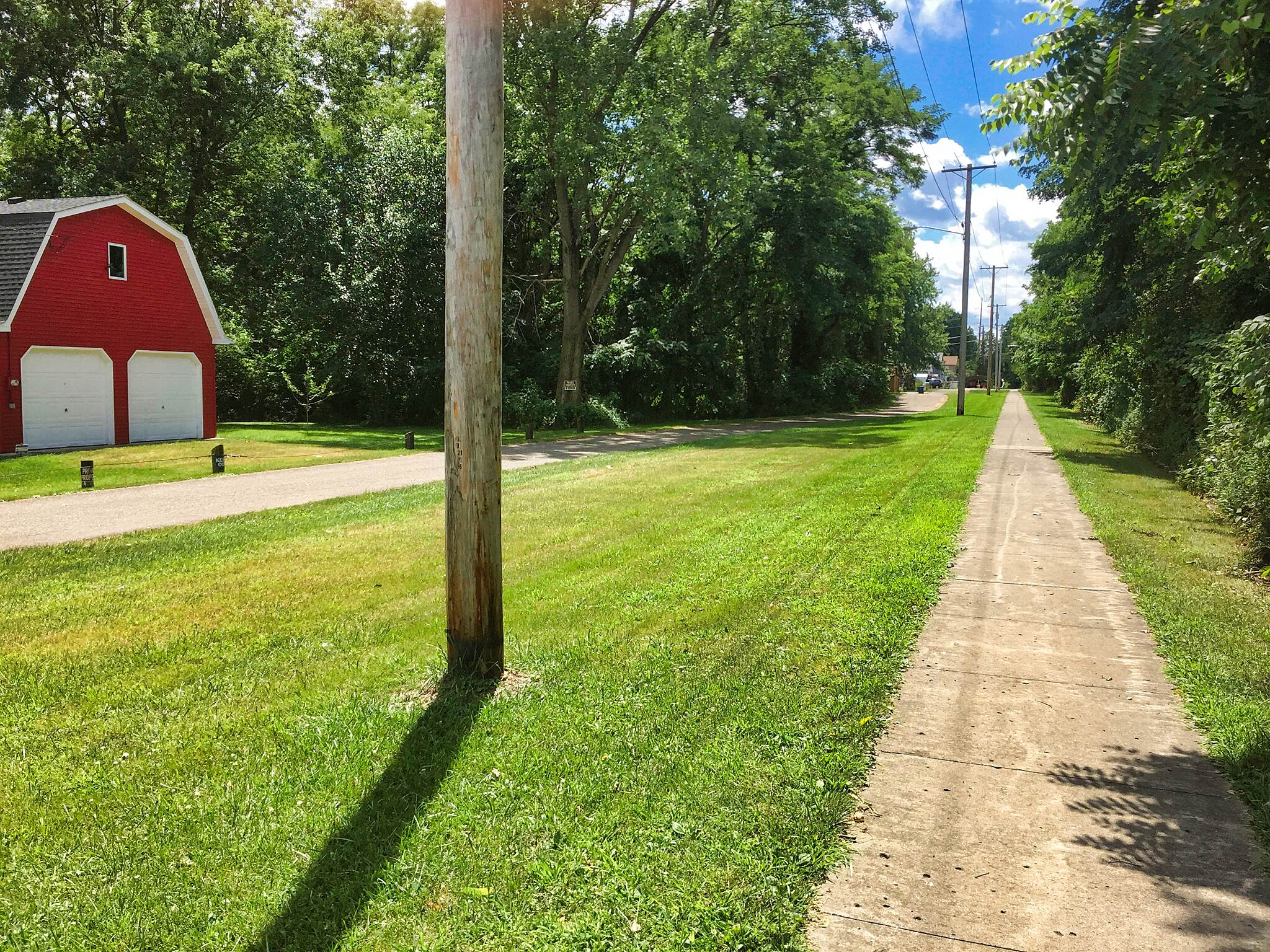 Newton Falls Trail Heading South Here is a view of the Newton Falls Trail heading south along High Street.  August 5, 2017.
