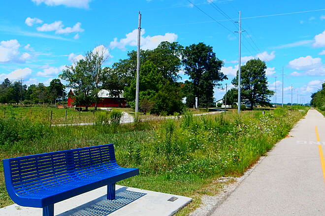 Nickel Plate Trail Time to rest. Benches along the trail south of Rochester are not common, but this one looks new. 8-7-16