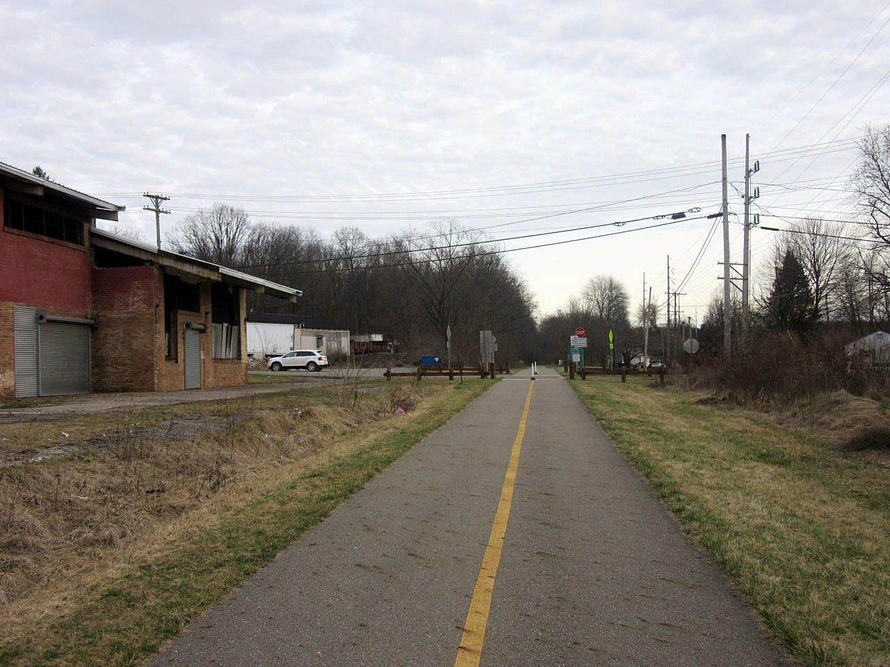 Niles Greenway Near the lot trail near the parking lot.  this old red building looks different every time.