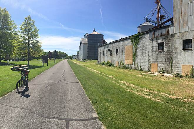 North Coast Inland Trail (Lorain County) Kipton Community Park Grain Elevator and Depot Buildings along the trail in Kipton, OH.  To the left of the trail is a community park with picnic facilities and a playground.  May 2017.
