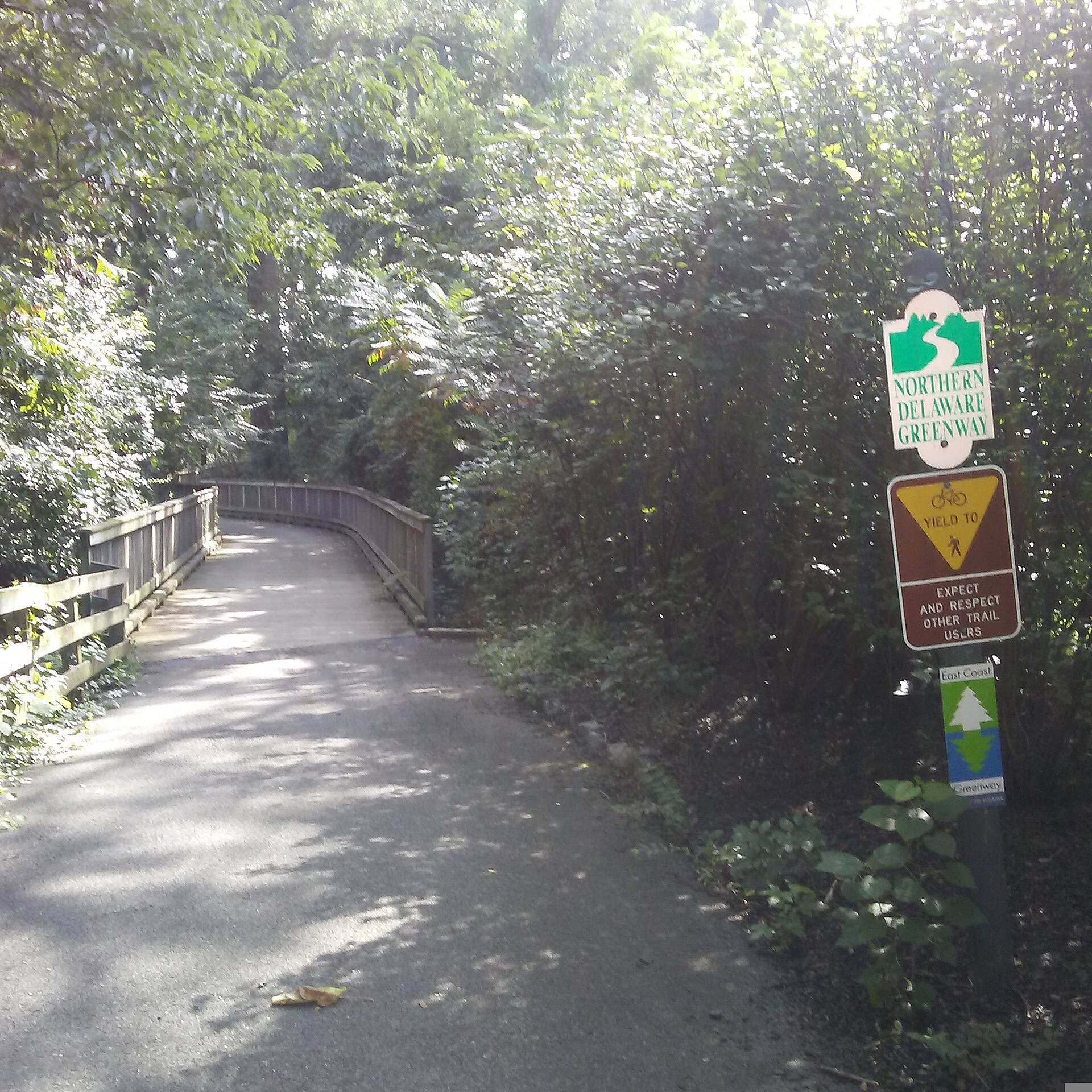 Northern Delaware Greenway Trail Northern Delaware Greenway Signs marking the trail as both the Northern Delaware Greenway and part of the East Coast Greenway are posted at the east end of the boardwalk off Weldin Ridge Drive.