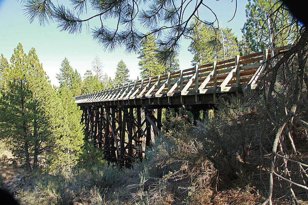 OC&E Woods Line State Trail Merritt Creek Trestle This trestle once carried trains along the Woods Line Railroad from the 1940s to the late 1980s. It's located at trail mile post 27, counting from Beatty. (This is 7.5 miles from Forest Road 27.)