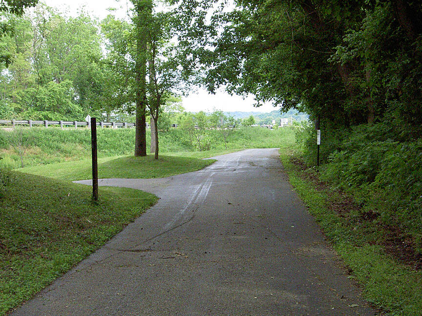 Paint Creek Recreational Trail Chillicothe May 2015 Eastbound trail continues to left under Veterans Pkwy, straight goes along Veterans Pkwy to US 50 in West Chillicothe