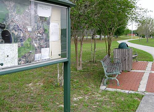 Palatka-Lake Butler State Trail   Trail map and bench in Keystone Heights