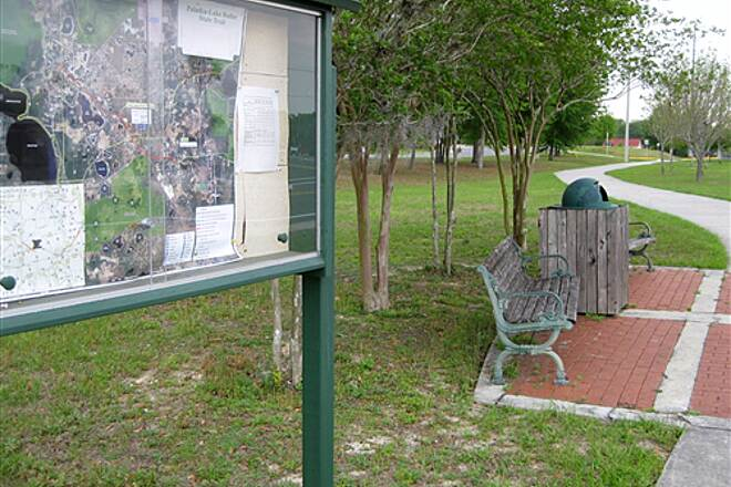 Palatka-to-Lake Butler State Trail   Trail map and bench in Keystone Heights