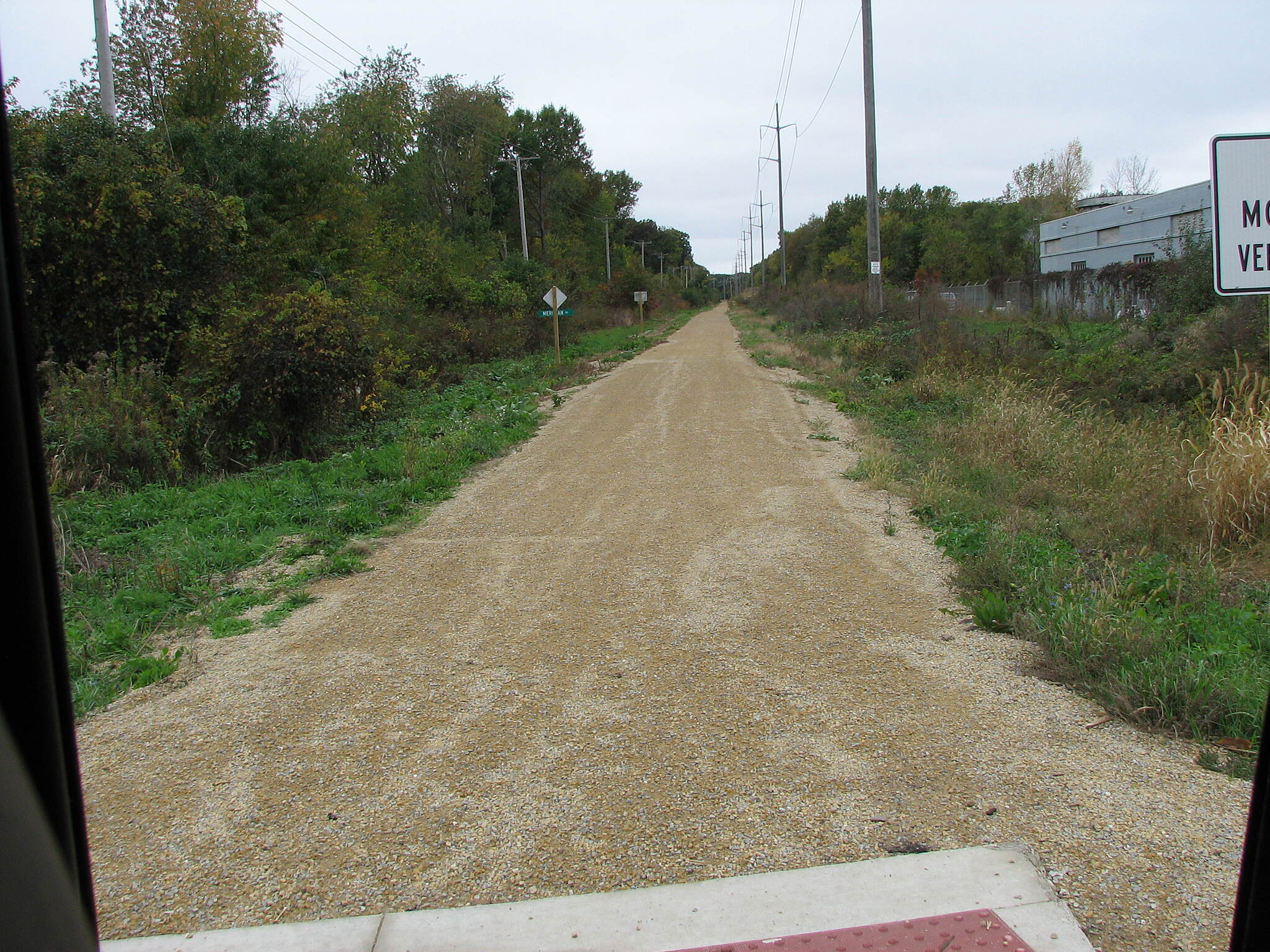 Pecatonica Prairie Trail Looking West at Meridian Road The eastern terminus is about a block south of US 20 on Meridian Road. No parking. No signs, but it is right under the big electric lines so it is hard to miss. There is a crosswalk painted across Meridian Road there is no trail on the other side.
