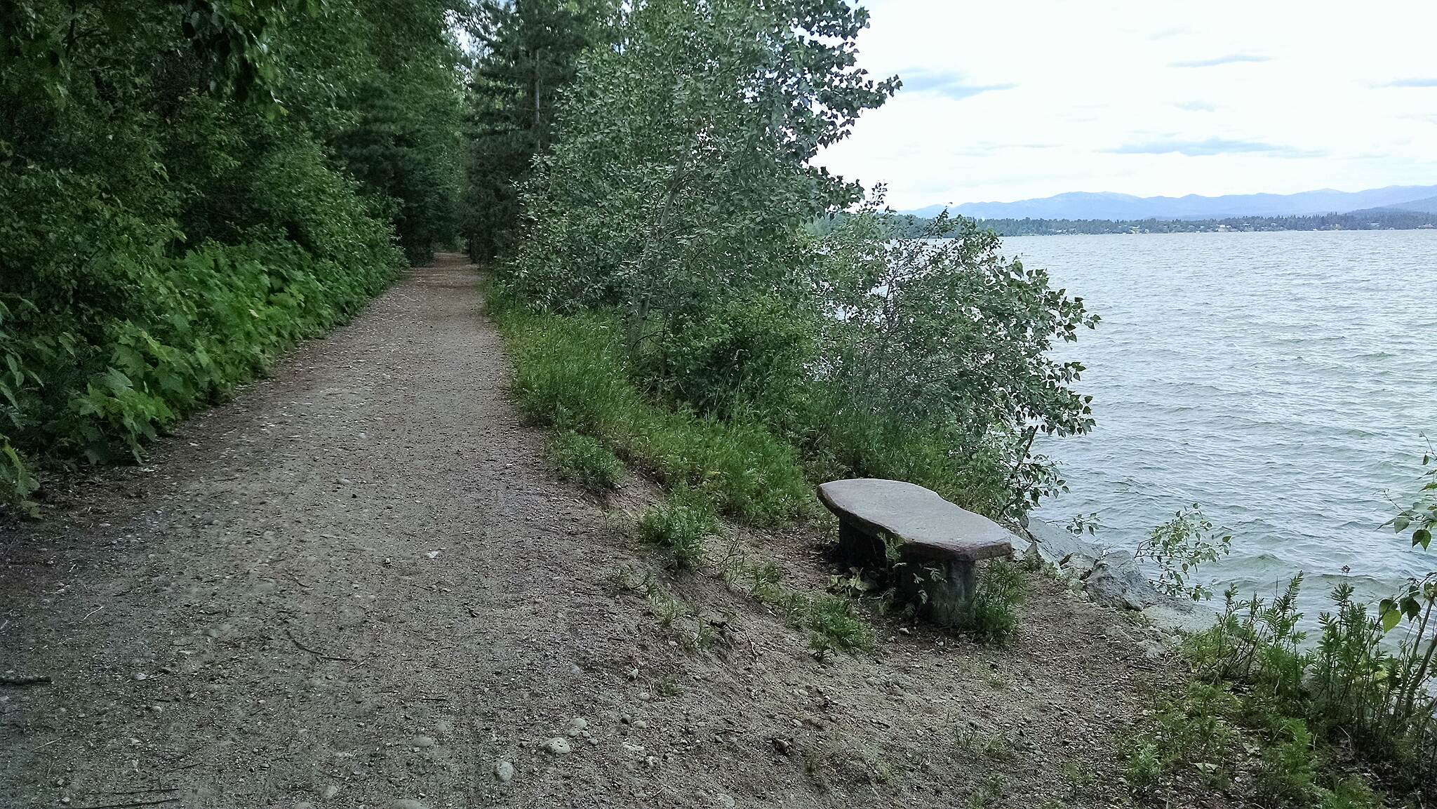 Pend d'Oreille Bay Trail One of the benches along the route Heading north on the west side of the bay