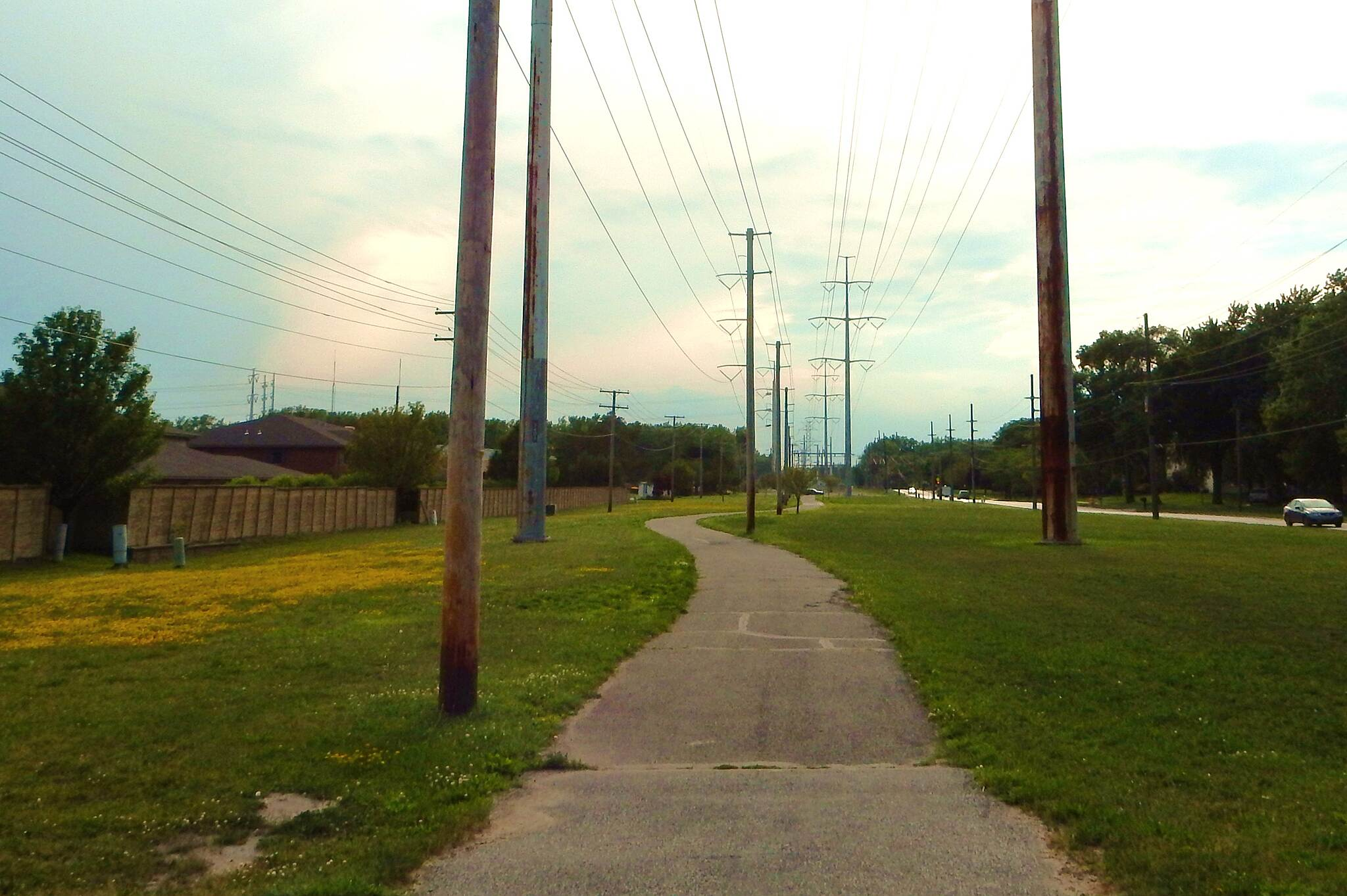 Pennsy Greenway Along Fisher Ave. Here the trail runs westward along Fisher Ave. west of Calumet Ave. Eventually, it veers north taking you into Lansing Ill. Taken 7-5-17.