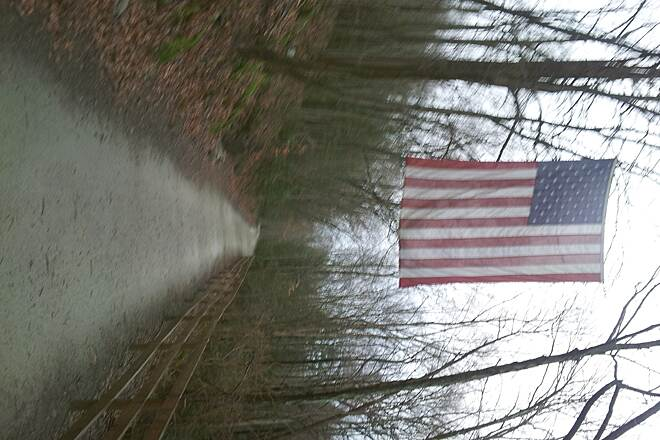 Pequonnock River Trail The flag you see when you reach .75 miles from the Tait Road lot.  Running out you are just about warmed up, on the way back, it means the run is almost complete.
