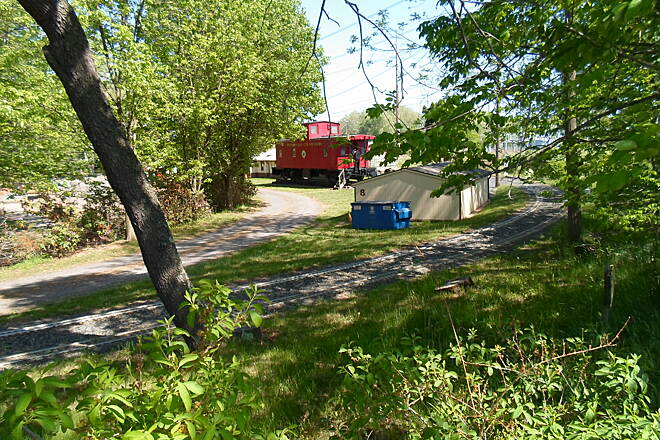 Perkiomen Trail Perkiomen Trail View of the caboose and miniature RR tracks on the property of the PA Live Steamers, located off the trail south of Graterford. Taken May 2015.