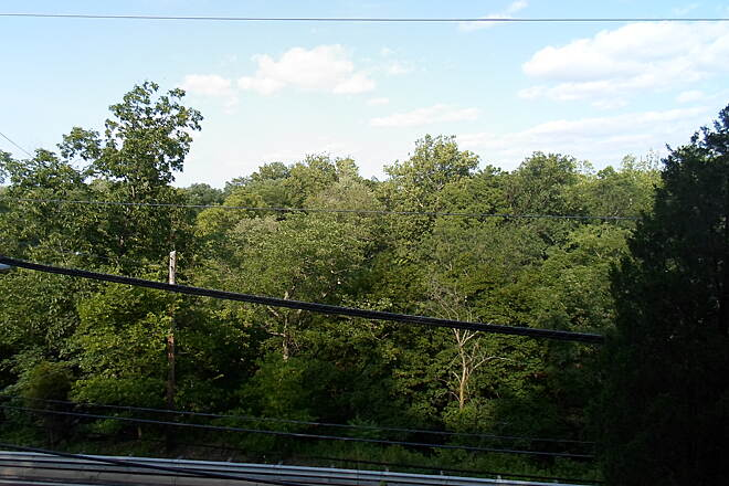 Perkiomen Trail Perkiomen Trail View over the treetops, across Route 29, from atop the east wall of the old RR ravine north of Collegeville.