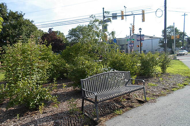 Perkiomen Trail Perkiomen Trail Metal bench at the quaint trailhead and pocket park in downtown Collegeville. Taken July 2015.