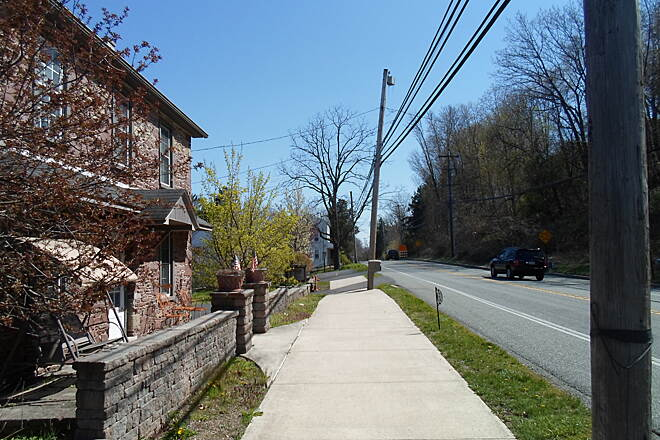 Perkiomen Trail Perkiomen Trail The trail briefly follows sidewalks in the vicinity of this quaint, stone home off Route 29 south of Schwenksville. Taken Apr. 2016.