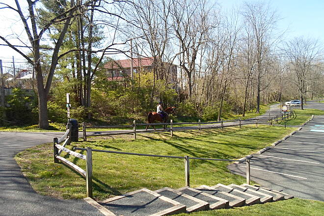 Perkiomen Trail Perkiomen Trail Woman on horseback riding through Central Perkiomen Valley Park. Taken Apr. 2016.