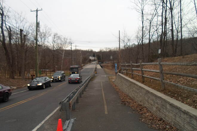 Perkiomen Trail Perkiomen Trail The trail briefly parallels Spring Mount Road on its south side across Perkiomen Creek, using a dual-use bridge.