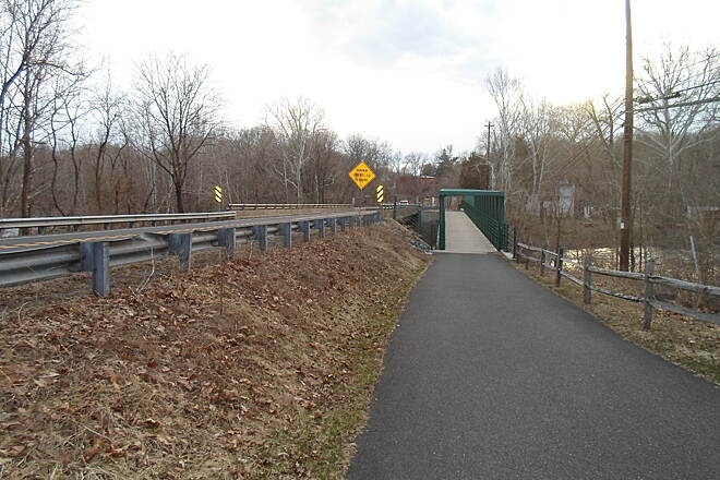 Perkiomen Trail Perkiomen Trail Approaching the larger of the two bridges along the trail on Schwenksville's east end. The larger bridge, seen ahead, crosses the Perkiomen Creek, immediately north of the one carrying Schwenksville Road.