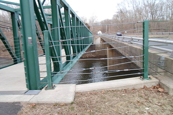Perkiomen Trail Perkiomen Trail Trail bridge (left) and Schwenksville Road bridge (right), seen side by side on the Perkiomen Creek's west bank. Taken April 2015.