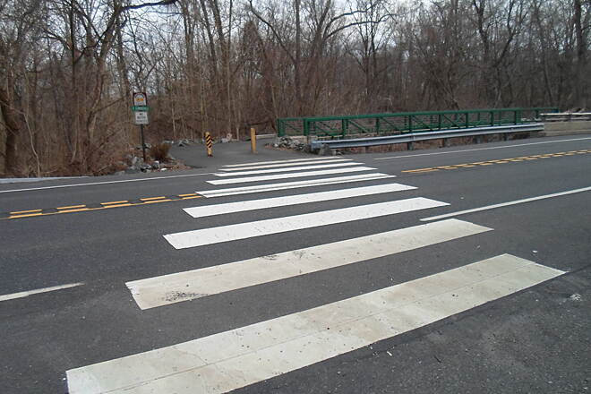 Perkiomen Trail Perkiomen Trail After crossing the bridge over the Perkiomen Creek, the trail cuts across Schwenksville Road on this crosswalk. There are no traffic signals on the road and vehicles often go by at high speeds, so caution is advised.