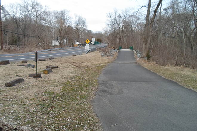 Perkiomen Trail Perkiomen Trail Looking east down the trail from Schwenksville, with the canal bridge seen in the background. Taken on a warm, early spring evening in April 2015.