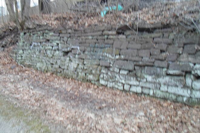 Perkiomen Trail Perkiomen Trail Old wall along the trail in Schwenksville. Was this from the railroad or canal? Taken April 2015.