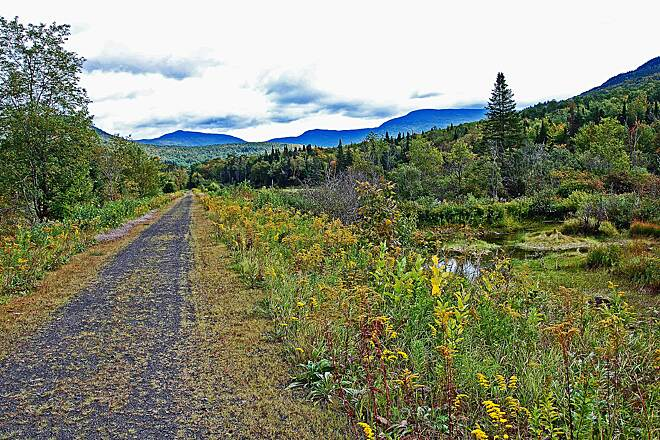 Presidential Rail Trail The White Mountains A view of the White Mountains riding from Randolph, NH toward Gorham, NH on the rail trail.