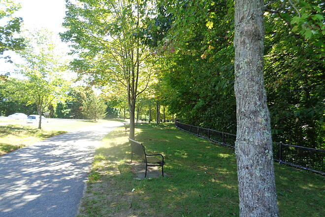 Quinebaug River Trail Near US 6 View south along the trail just south of the US 6 crossing showing the numerous benches and picnic tables.