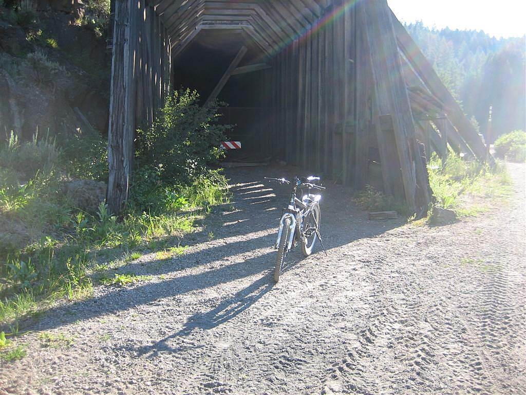 Railroad Right-of-Way Trail My mountain bike at the tunnel. The bypass around the cave-in tunnel is to the right side.