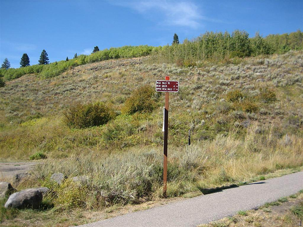 Railroad Right-of-Way Trail The Trailhead at Warm River Campground. The sign says that this is the Mesa Falls Trail, and that it is 4 miles to Bear Gulch, and 7 miles to Upper Mesa Falls.  The trail to Bear Gulch is only open to bikes, hikers, and horse riders.