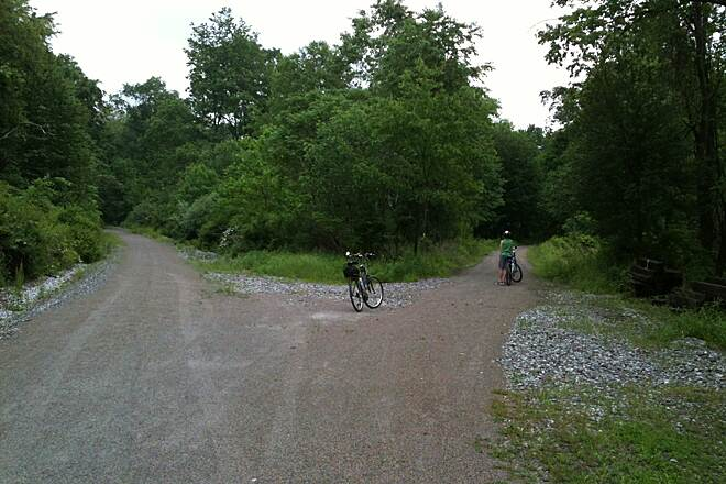 Redbank Valley Rail Trail Y at about MP 19.5 looking East Left is main trail to New Bethlehem. Right is short ride to a bridge over the creek and then a dead end at Kohlersburg Rd.