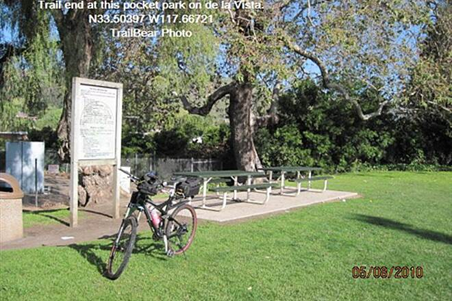 Robert McCollum Memorial Bicycle Trail TRABUCO CREEK - EAST BANK TRAIL, SJC, CA. Here is more - two tables, a trash can and regulations.