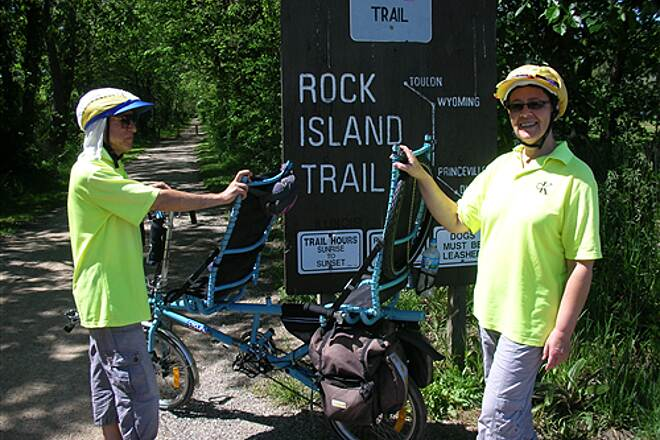 Rock Island Trail (IL) Robert & Jana trom Melbourne, Australia on tandem blue entrance to the trail in Peoria