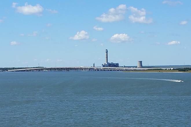 Route 52 Bridge Trail Great Eggharbor Bay The photo is a beautiful shot of the bay. In the background is the Garden State Parkway and Beasley Point power generation plant. Location was the second high point on the north end of the trail.