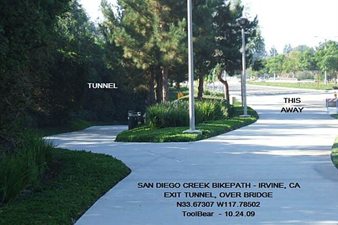 San Diego Creek Trail San Diego Creek Bikeway, Irvine, CA Out of the tunnel, up, hard 180 left and over bridge.