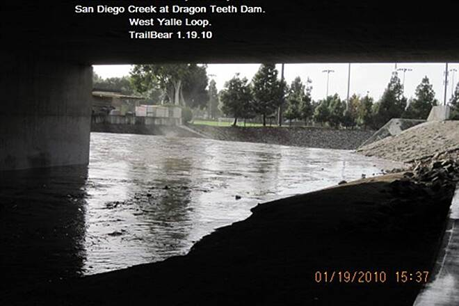 San Diego Creek Trail San Diego Creek Trail - the creek in flood. Here goes trouble.  See what is below the dam.