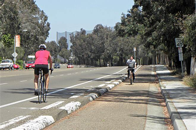 San Diego River Trail  On Friars Rd. between Napa St. and Fashion Valley Rd. cyclists have a choice of a sooth bike lane next to traffic or a separated 2-way trail that's not always so smooth.