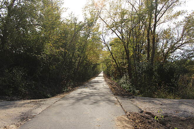 Sangamon Valley Trail Trail entrance from the parking area This photo was taken further South of the Sangamon River. The path off to the right is to the parking area which is approximately 2 mile South f the North end at Irwin Bridge Road. Looking South.
